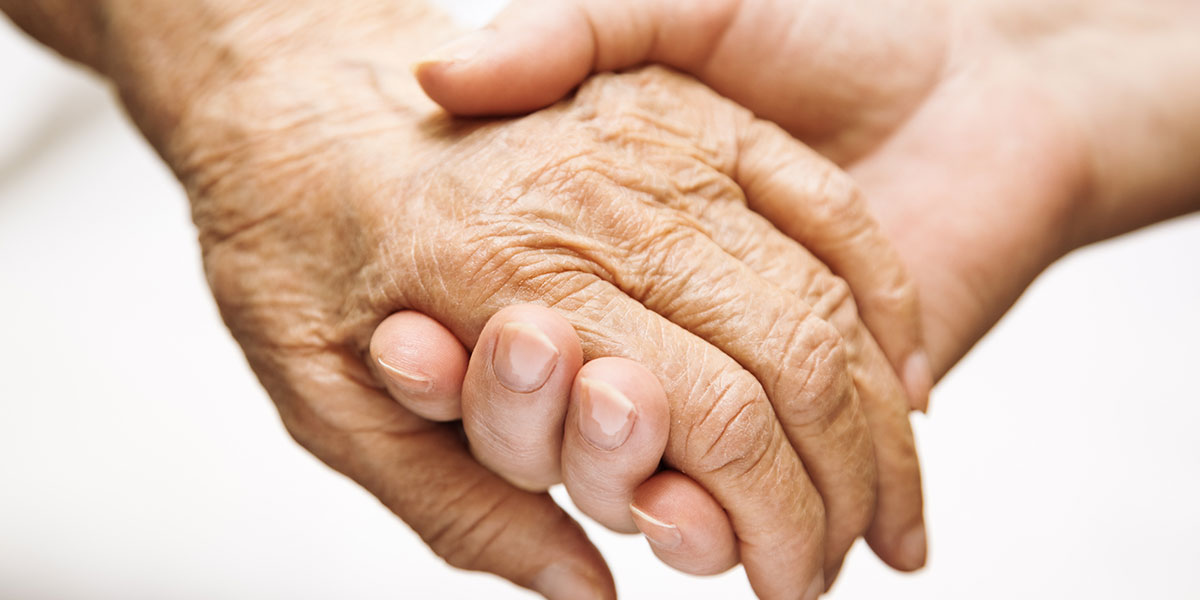 Hand of an elderly being held